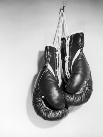 ewing-galloway-boxing-gloves-hanging-on-the-wall